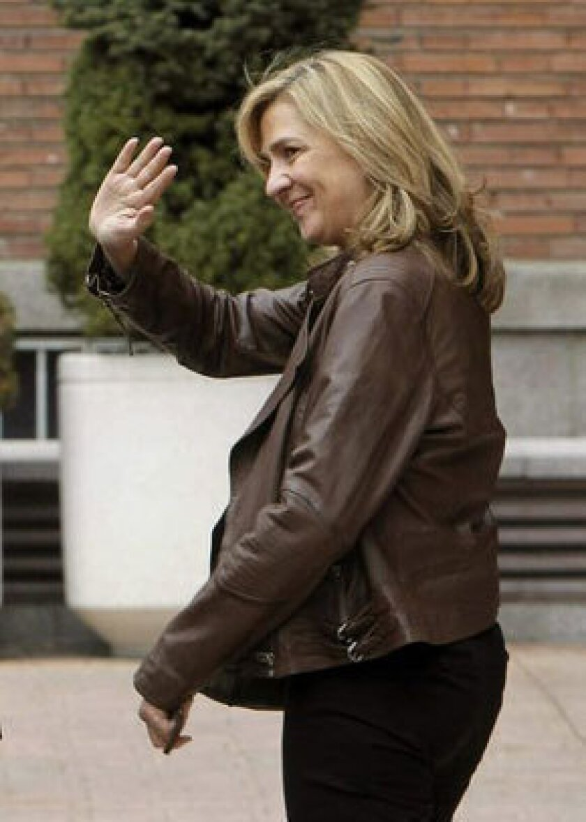 Spain's Princess Cristina, shown in Madrid in March, has been cleared in a corruption probe that has ensnared her husband and thrown a shadow over the royal family.