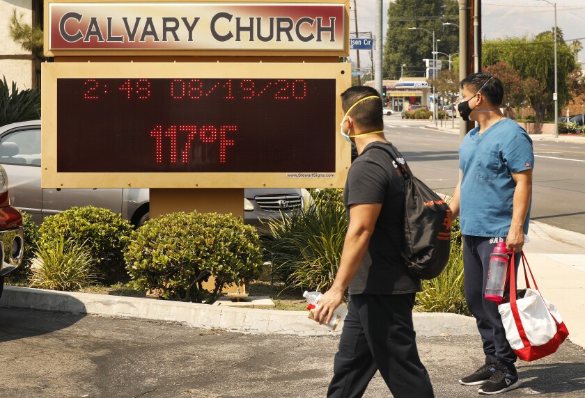 The thermometer at Calvary Church in Woodland Hills registers 117 degrees during a heat wave last month.