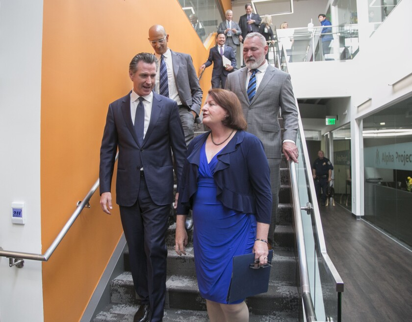 State Senate leader Toni Atkins, shown in San Diego in August with Gov. Gavin Newsom, say she and Newsom hope to pass a housing production bill this year, despite the failure of Senate Bill 50.