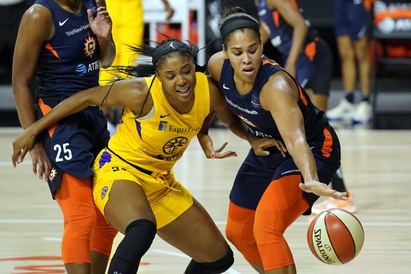 Connecticut Sun center Brionna Jones, right, steals the ball from Sparks center Kristine Anigwe.