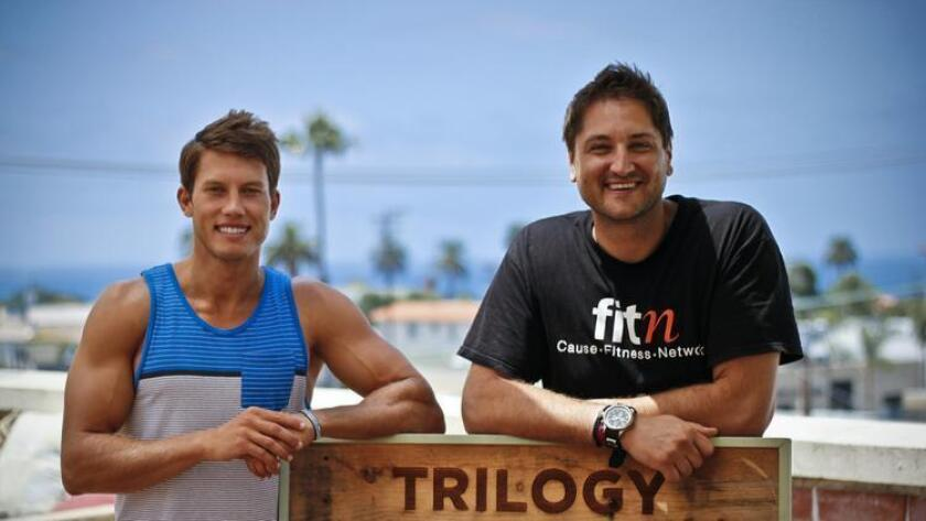David Metzler, FITn CEO (right) and Mike Sherbakov, FITn ambassador and local yoga instructor (left) on the rooftop of FITn member studio Trilogy in La Jolla. (/ Lauren Richer)