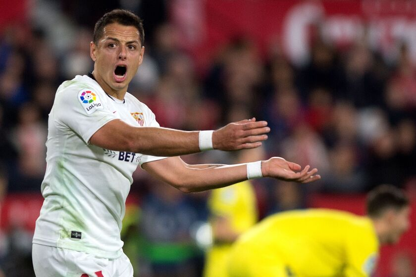 "Sevilla's Mexican forward ""Chicharito"" reacts during the Spanish league football match between Sevilla FC and Villarreal CF."