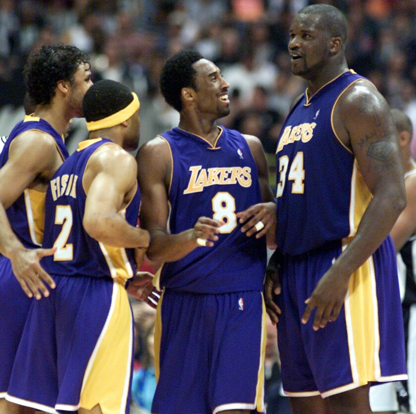 Kobe Bryant is congratulated by teammates Shaquille O'Neal, Derek Fisher and Rick Fox  after drawing a foul in a 104-90 victory over the Spurs.