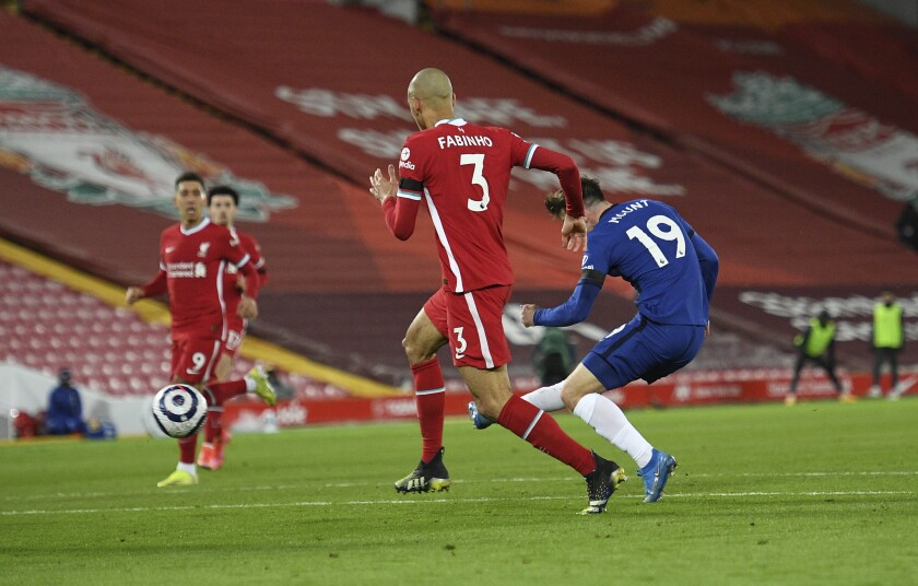 Chelsea's Mason Mount, right, scores his side's opening goal during the English Premier League soccer match between Liverpool and Chelsea at Anfield stadium in Liverpool, England, Thursday, March 4, 2021. (Oli Scarff, Pool via AP)