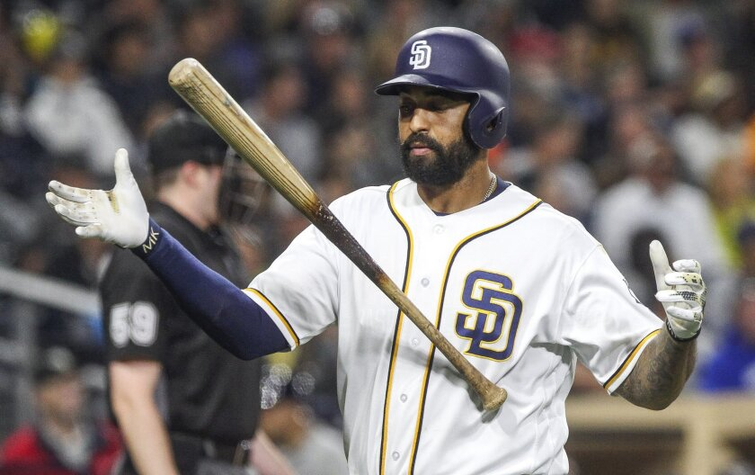 The Padres' Matt Kemp catches his bat after tossing it up after striking out in the fifth inning.