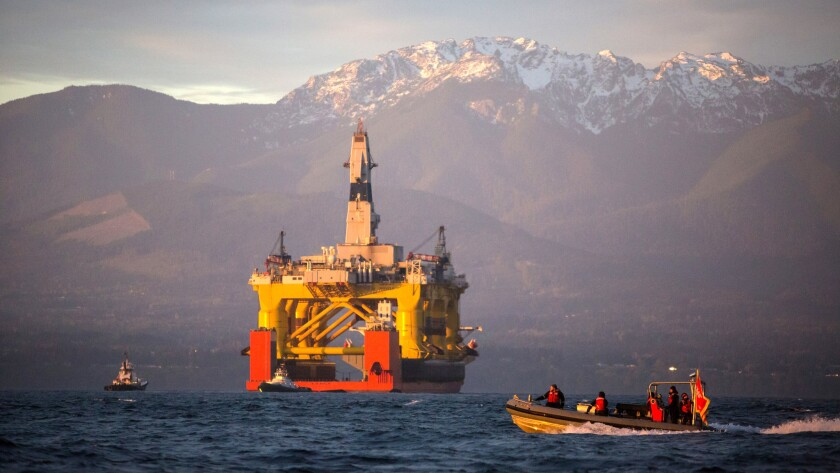 With the Olympic Mountains in the background, an Arctic-bound oil drilling rig arrives in Port Angeles, Wash., in 2015.