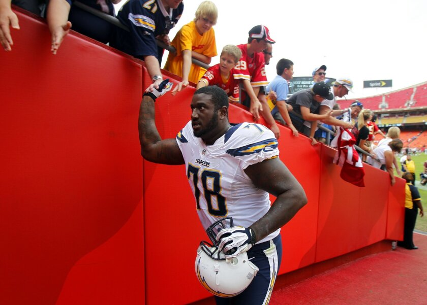 Chargers Jared Gaither celebrates after a win against the Chiefs on Sunday, Sept. 30, 2012.