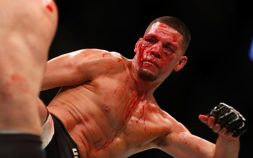 Nate Diaz kicks attempts a kick during his welterweight bout against Conor McGregor on Aug. 20, 2016.