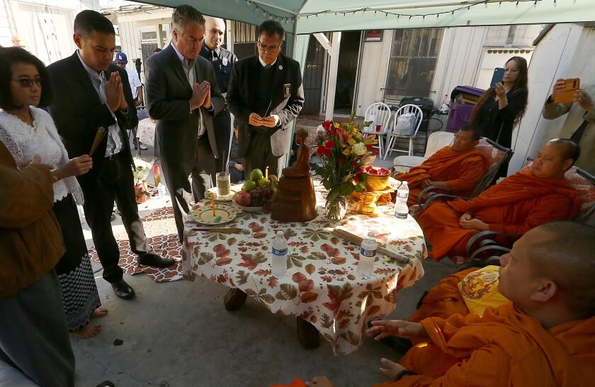 Long Beach Mayor Robert Garcia attends a Buddhist memorial ceremony