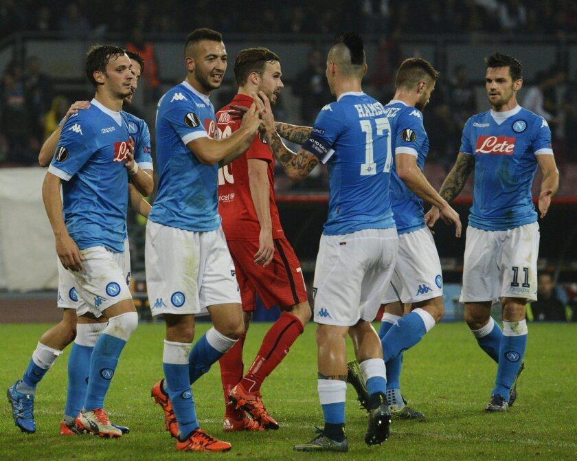 Napoli's players celebrate during the Europa League soccer match between Napoli and Midtjylland, at the San Paolo stadium in Naples, Italy, Thursday, Nov. 5, 2015. (AP Photo/Salvatore Laporta)