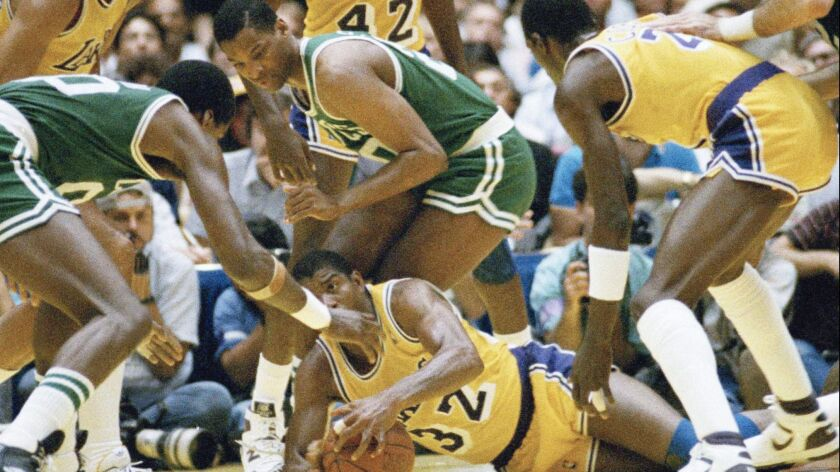 """FILE - In this June 2, 1987, file photo, Los Angeles Lakers' Earvin """"Magic"""" Johnson scrambles for th"""
