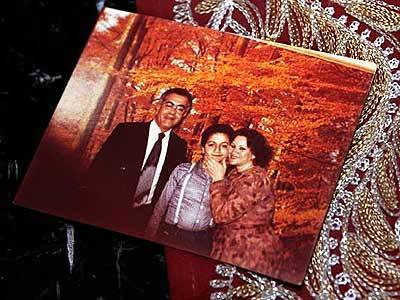 A family photograph showing a young Mohamed Atta and his parents.
