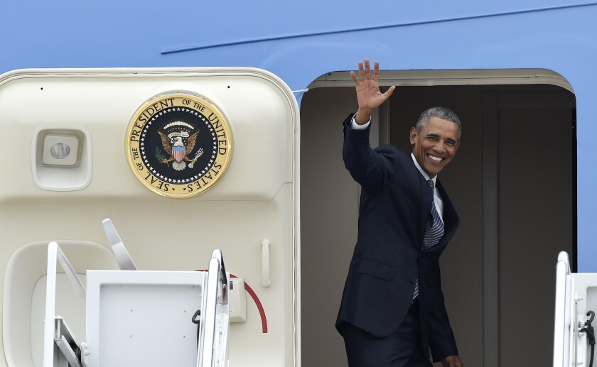 President Obama waves from Air Force One at Andrews Air Force Base, Md., Monday, Aug. 31, 2015.