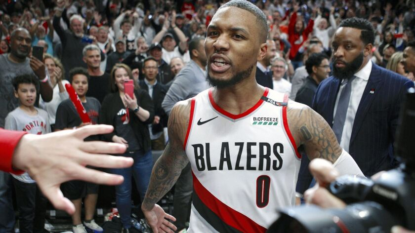 Portland Trail Blazers' Damian Lillard leaves the court after hitting the game-winning three-pointer
