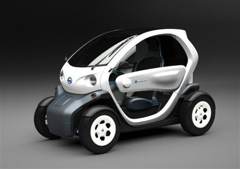 "In this artist rendering released by Nissan Motor Co., a two-seater electric vehicle called ""Nissan New Mobility CONCEPT,"" resembling a go-cart the Japanese automaker unveiled to the media during a press conference Monday, Nov. 1, 2010 at its headquarters in Yokohama near Tokyo. It has a range of a 100 kilometers (62 miles), and maximum speed of 75 kilometers (47 miles) per hour. The EV system was developed by Renault, but the car's design was by Nissan. (AP Photo/Nissan Motor Co.)"