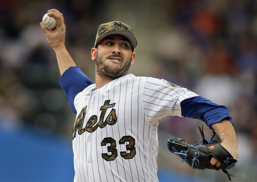 FILE - In this May 30, 2016, file photo, New York Mets starting pitcher Matt Harvey throws during the first inning of a baseball game against the Chicago White Sox in New York. Harvey (4-10) starts Monday, July 4, 2016, for the Mets against the Miami Marlins. (AP Photo/Seth Wenig, File)