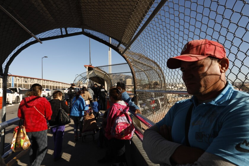 Cuban migrant Yunier Reyes, 35, waits with other migrants from Honduras and Mexico.