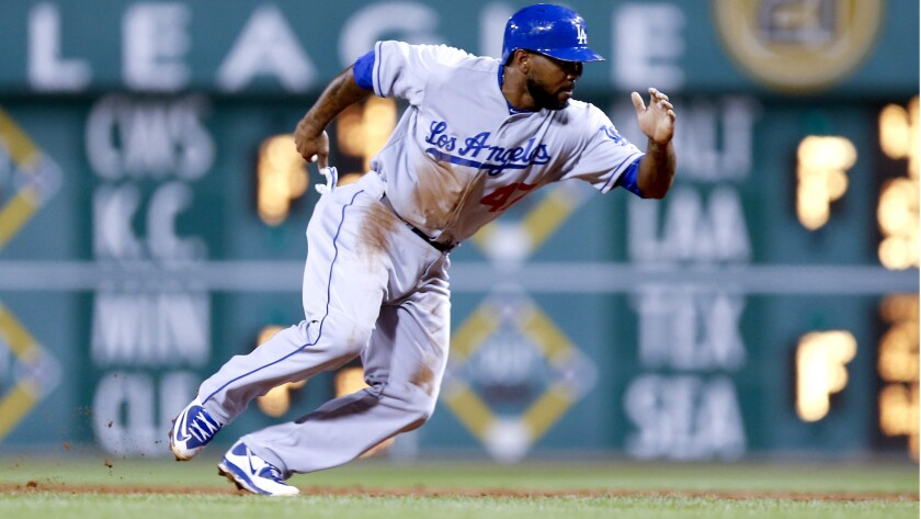 Second baseman Howie Kendrick strained his left hamstring during the Dodgers' game against the Pirates on Sunday in Pittsburgh.