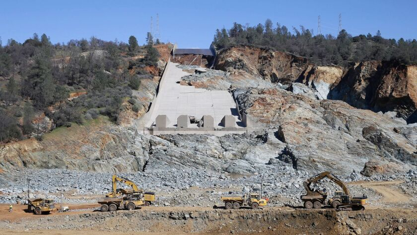 Construction crews clear rocks from Oroville Dam's eroded spillway on Feb. 28. (Rich Pedroncelli / Associated Press)