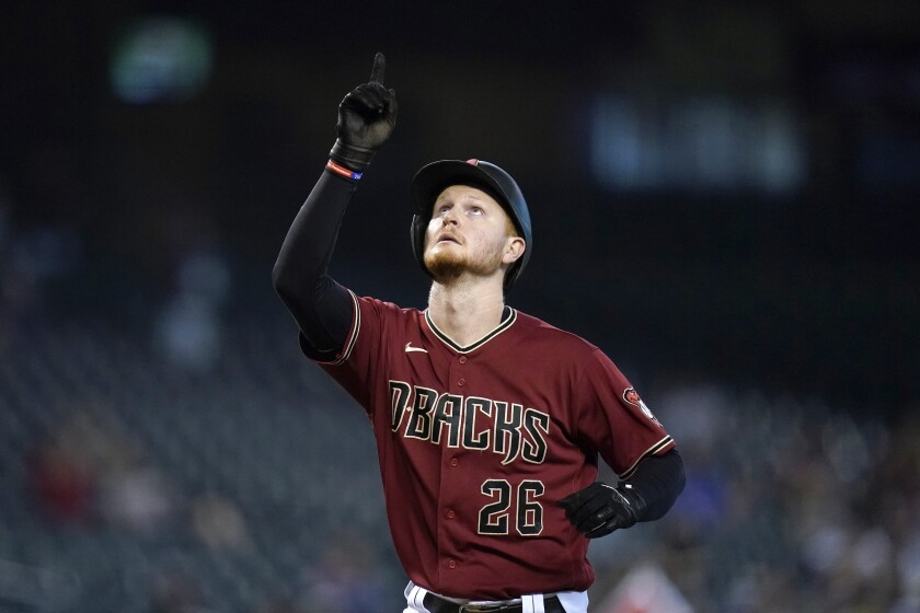 Arizona Diamondbacks' Pavin Smith points to the sky as he arrives at home plate after hitting a home run against the Pittsburgh Pirates during the seventh inning of a baseball game Wednesday, July 21, 2021, in Phoenix. The Diamondbacks defeated the Pirates 6-4. (AP Photo/Ross D. Franklin)