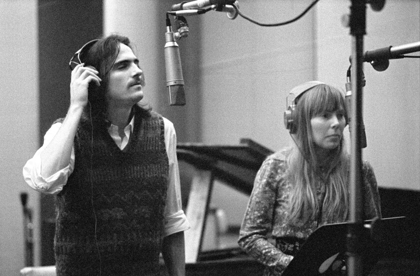 "James Taylor and Joni Mitchell recording background vocals for Carole King's ""Tapestry."""