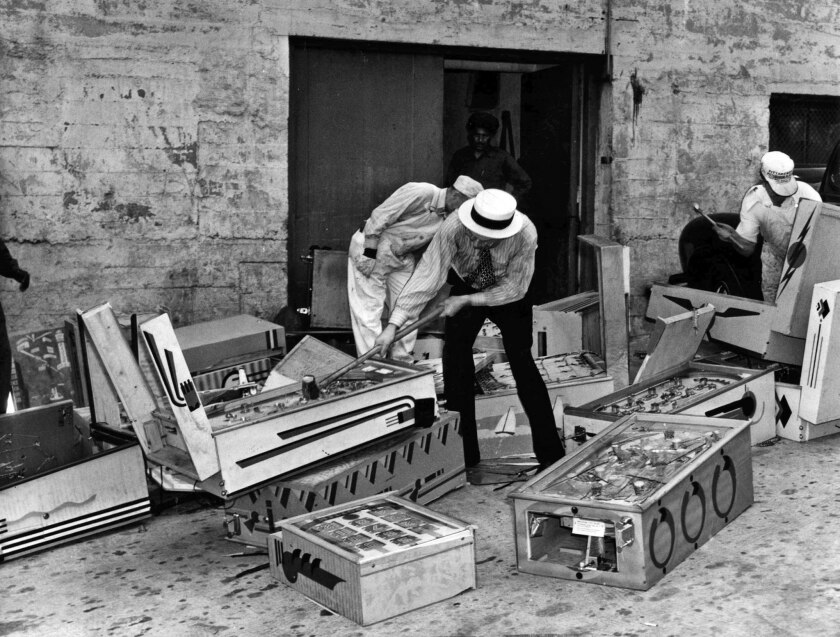 May 15, 1940: Urban F. Emme, chief clerk of City Marshal's office, wields a sledgehammer on confiscated pinball and other marble machines that had been ordered destroyed by Municipal Court judges.