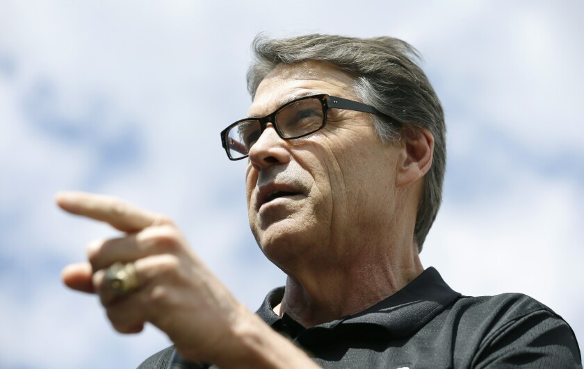 Texas Gov. Rick Perry, shown in Iowa last week, met Wednesday with troops who will deploy to the U.S.-Mexico border.