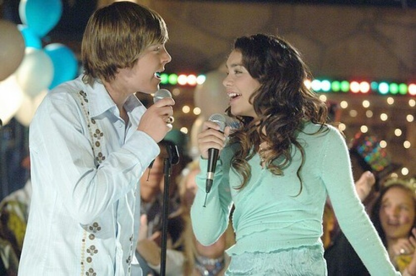 "Zac Efron and Vanessa Hudgens singing in ""High School Musical"""