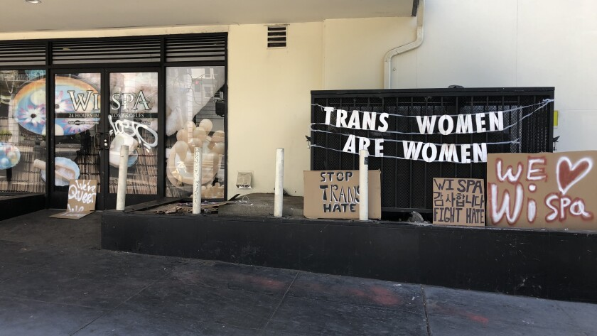 Signs supporting transgender rights are displayed outside the Wi Spa in Koreatown.