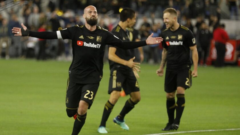 Laurent Ciman acknowledges cheers from the crowd after scoring the game-winning goal against the Seattle Sounders in LAFC's first game at Banc of California Stadium.