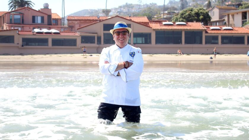 Chef Bernard Guillas poses in the sea he has stared out at from The Marine Room in La Jolla nearly every day for more than 20-plus years.