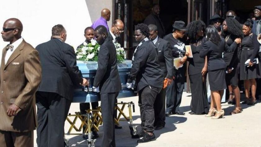 Pallbearers carry the casket of Alfred Olango, who was shot killed by an El Cajon police officer, to a waiting hearse after a funeral service at Bayview Baptist Church in San Diego on Saturday.