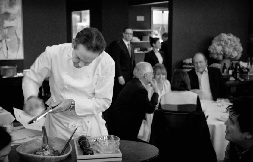 Thomas Keller preparing caesar salad tableside