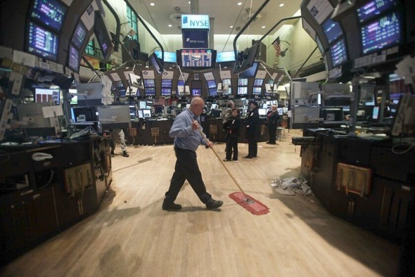 A worker cleans the floor of the New York Stock Exchange.