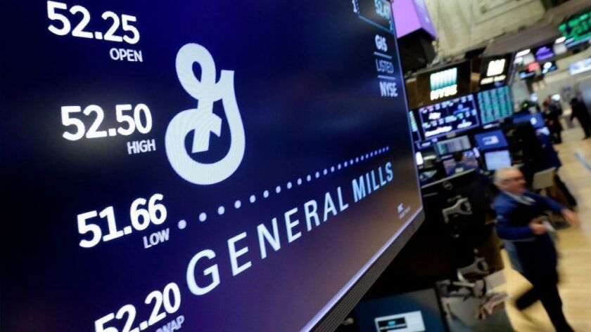 The logo for General Mills appears above a trading post on the floor of the New York Stock Exchange on Feb. 23, 2018. General Mills said Jan. 24, 2019, that it is recalling some bags of its Gold Medal Unbleached Flour because of salmonella concerns.