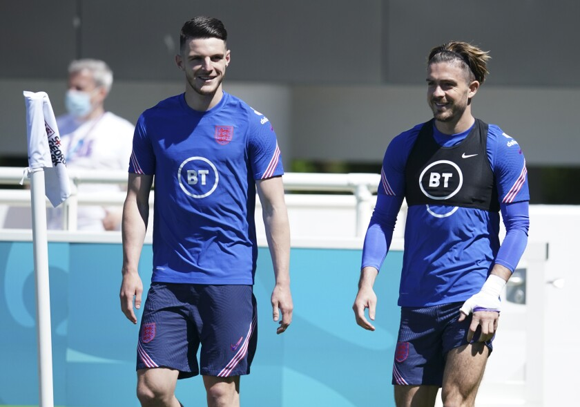 England's Declan Rice, left, and England's Jack Grealish arrive for an open training session at St. George's Park, Burton-upon-Trent, Wednesday June 9, 2021. The Euro 2020 soccer championship gets underway on Friday June 11 and is being played in 11 host cities across 11 countries. The event was delayed by one year after being postponed in 2020 due to the COVID-19 pandemic. (AP Photo/Dave Thompson)