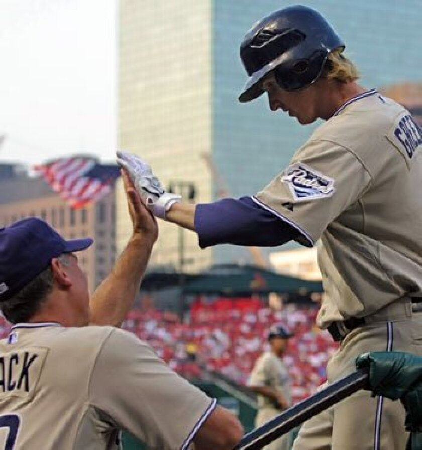 Khalil Greene, shown in this file photo being congratulated by manager Bud Black after hitting a home run in July, is the latest Padres player drawing trade interest.
