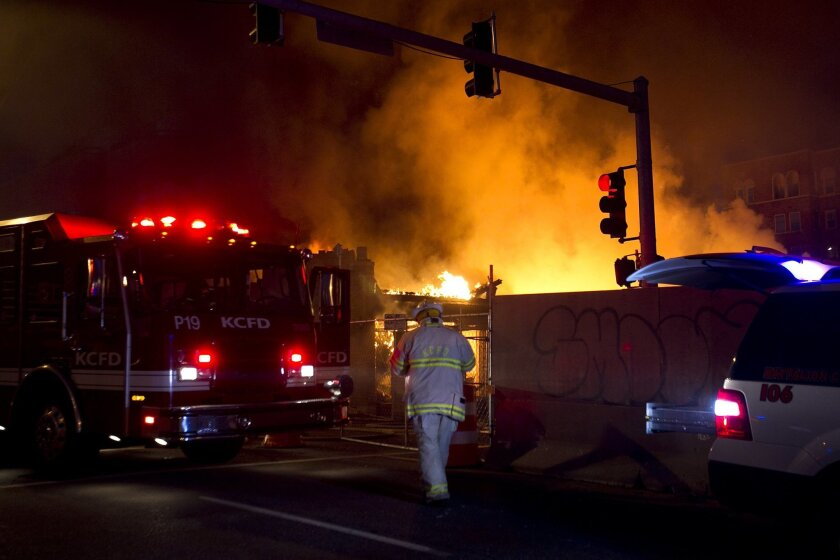 FILE - In a Feb. 19, 2013 file photo, firefighters are on the scene of a gas explosion and massive fire at JJ's restaurant at the Country Club Plaza in Kansas City, Mo. Jurors ruled Thursday, Aug. 27, 2015, that Time Warner Cable must pay nearly $6 million as part of a lawsuit alleging it was large