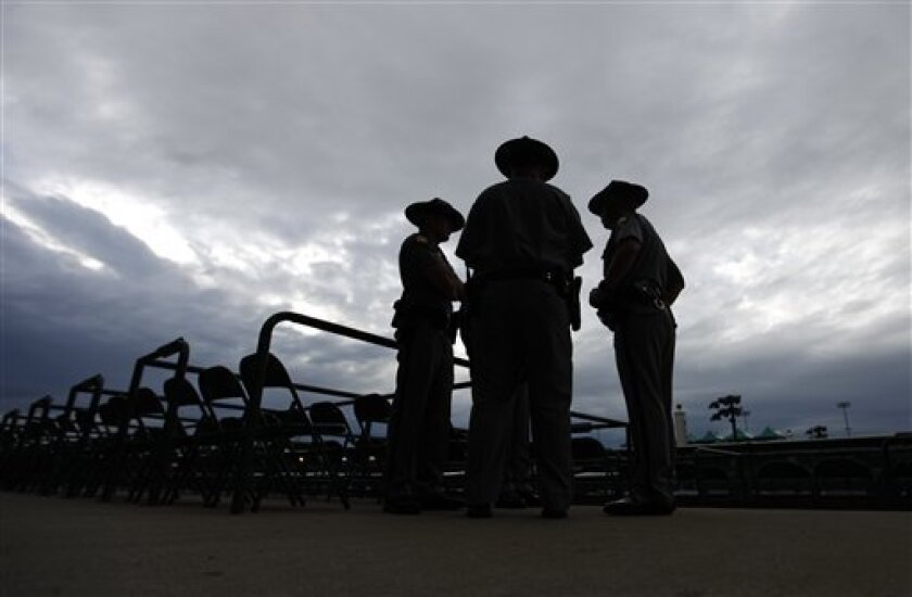 Kentucky State Police wait for spectators to arrive for the running of the 139th Kentucky Derby at Churchill Downs Saturday, May 4, 2013, in Louisville, Ky. (AP Photo/David Goldman)
