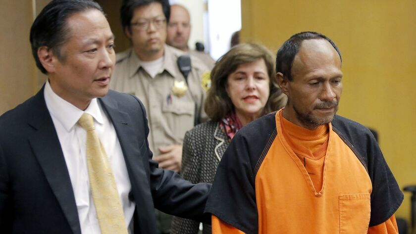 Jose Ines Garcia Zarate is led into court in 2015 by San Francisco Public Defender Jeff Adachi and Assistant Dist. Atty. Diana Garcia for his arraignment in San Francisco.