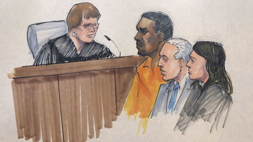 In this courtroom sketch, R&B singer R. Kelly, center, appears before U.S. Magistrate Shelia M. Finn