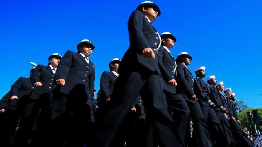 Sailors stationed in San Diego took part in the 2015 Veterans Day parade along Harbor Drive.