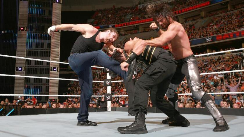 """""""Essential"""" in Florida: Dean Ambrose, left, and Seth Rollins, right, gang up on Roman Reigns."""