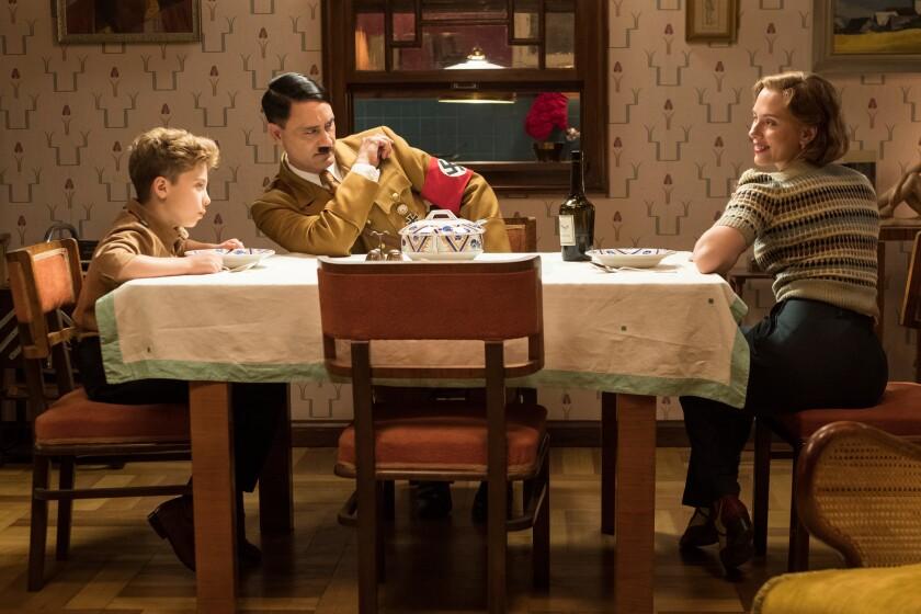 """Roman Griffin Davis, left, Taika Waititi and Scarlett Johansson in """"Jojo Rabbit"""""""