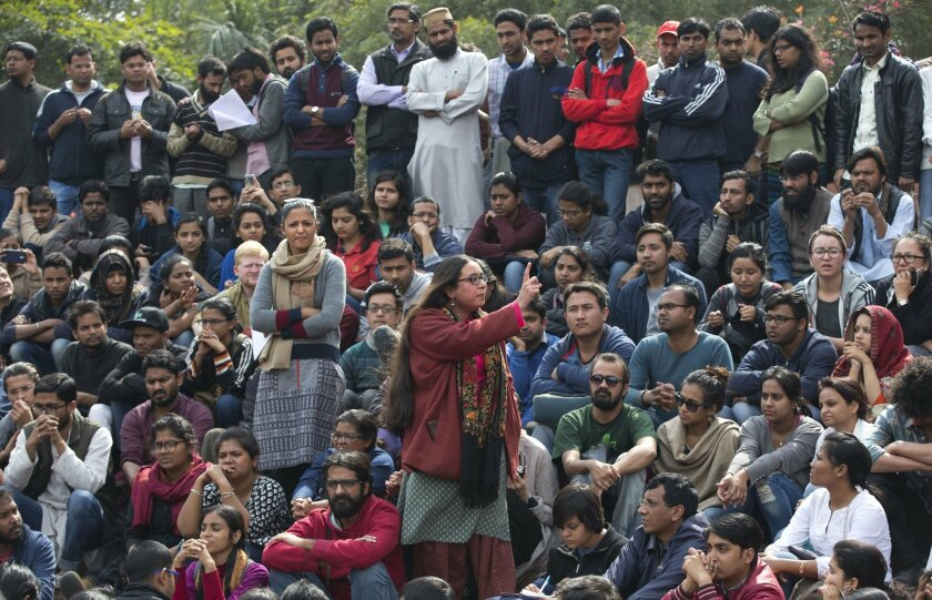 A student makes her speech as Jawaharlal Nehru University students gather for a protest against the arrest of a student union leader in New Delhi, India, Monday, Feb. 15, 2016. Massive protests paralyzed one of India's top universities Monday after the president of the student union was arrested on
