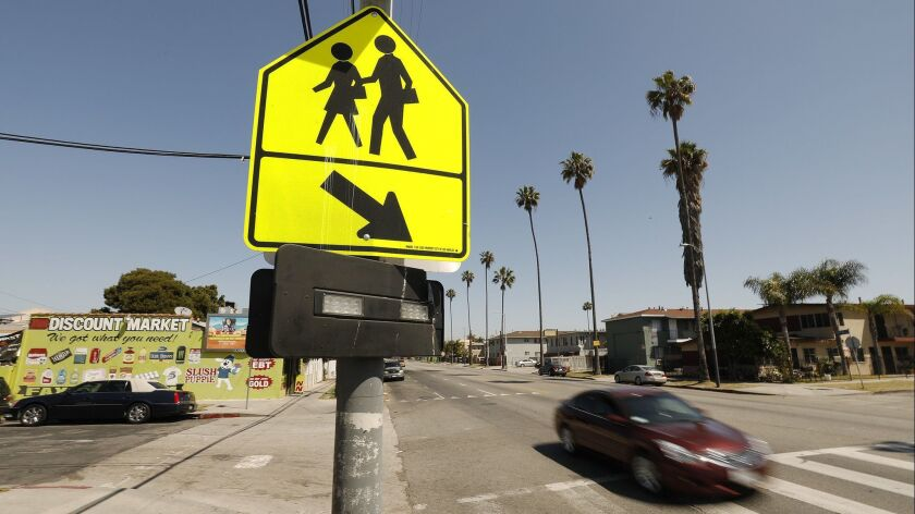 A crosswalk at 94th and Figueroa streets in Los Angeles