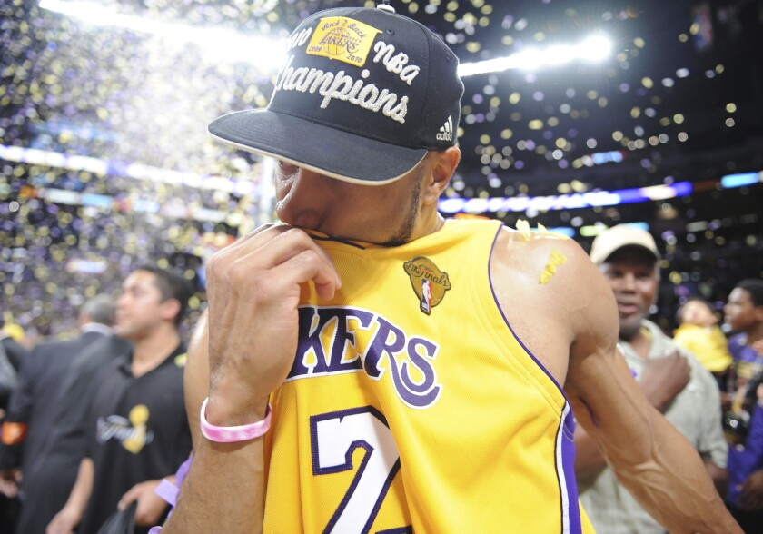 Derek Fisher kisses his Lakers jersey after the team's win over the Boston Celtics in Game 7 of the 2010 NBA Finals.
