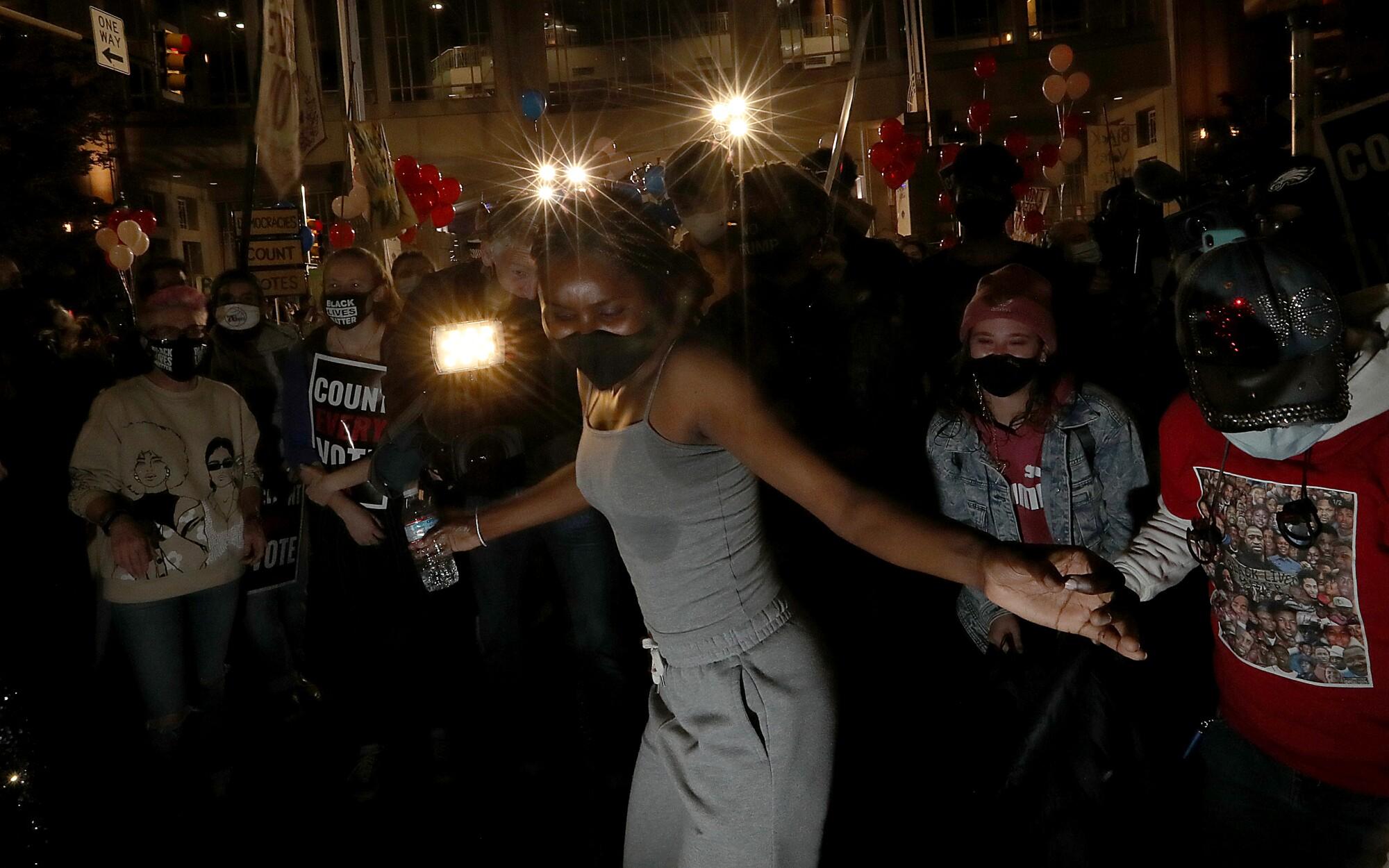 Protesters dance in the dark