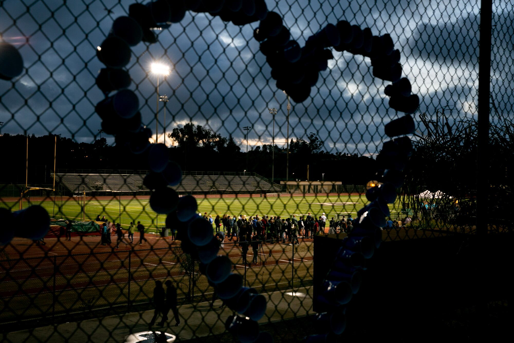 Community members gather at Poway High School on April 29, 2019, for a vigil following the shooting at Chabad of Poway.