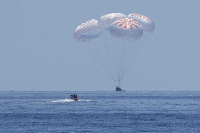 SpaceX's Crew Dragon capsule lands in the Gulf of Mexico.